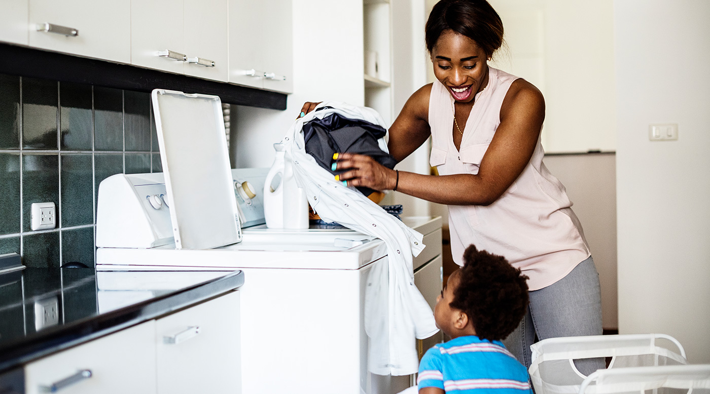 mom and son doing laundry together