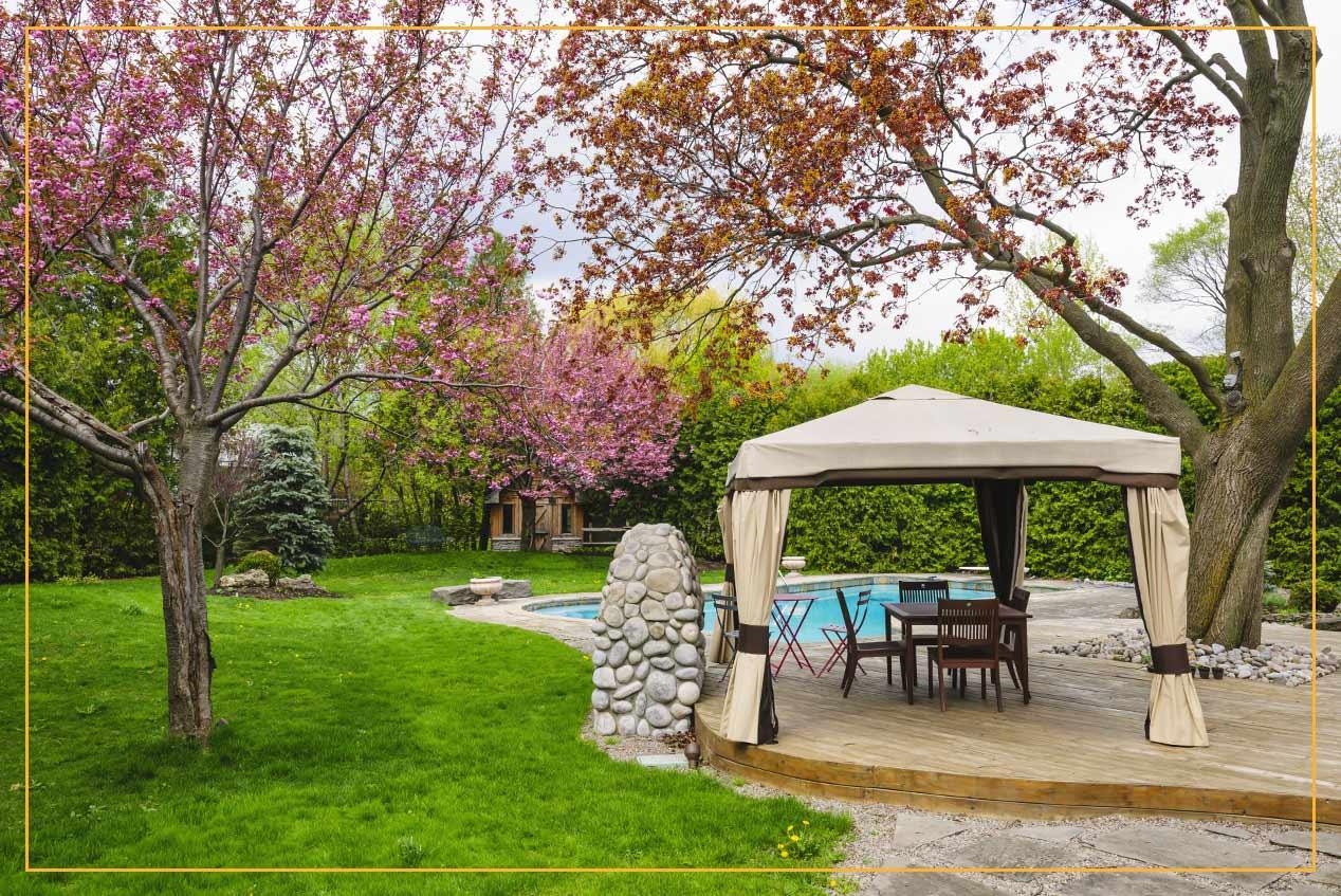 portable gazebo in backyard by pool
