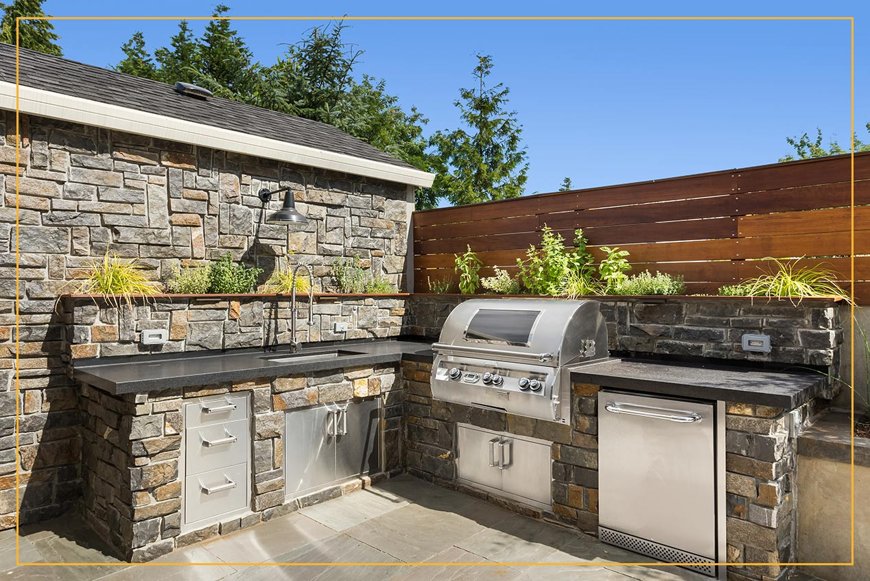stone veneer outdoor patio grilling area