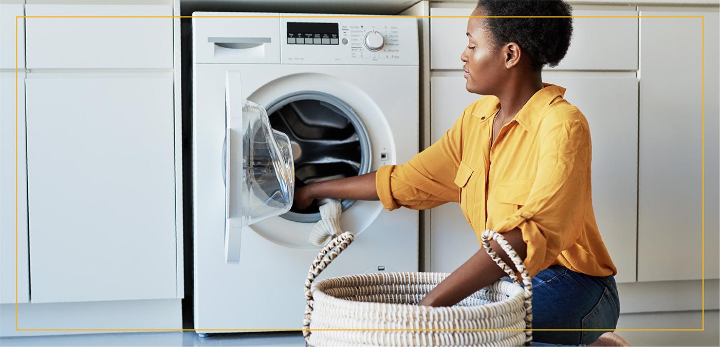 woman loading laundry into machine
