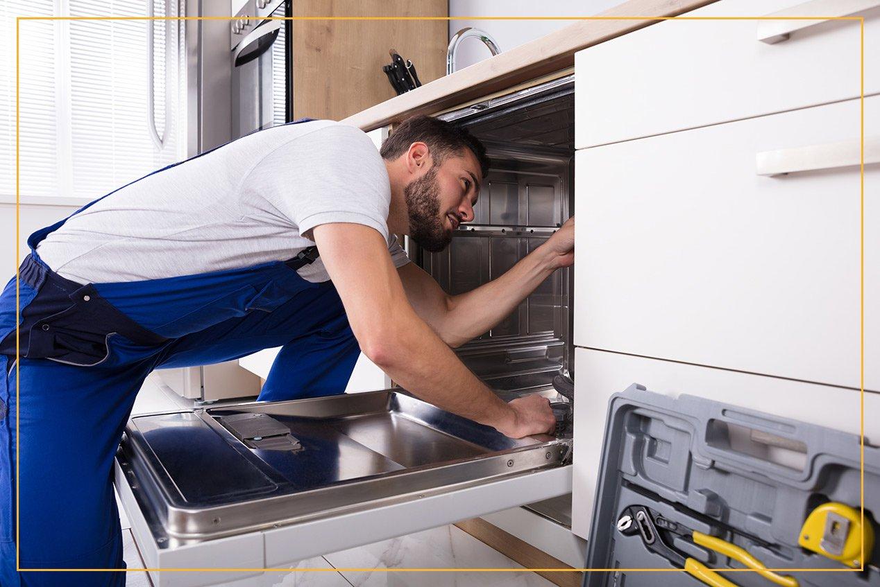worker installing appliance