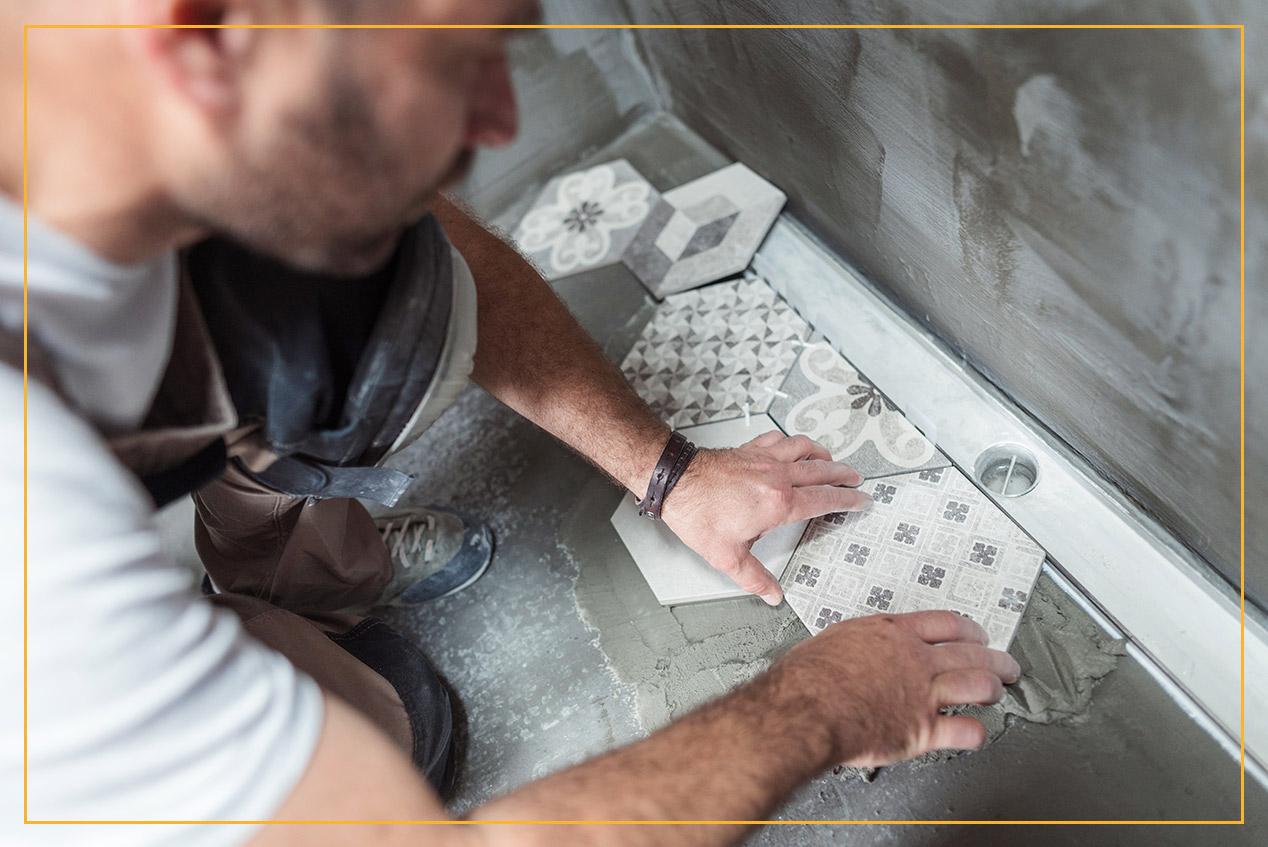 worker installing floor tile