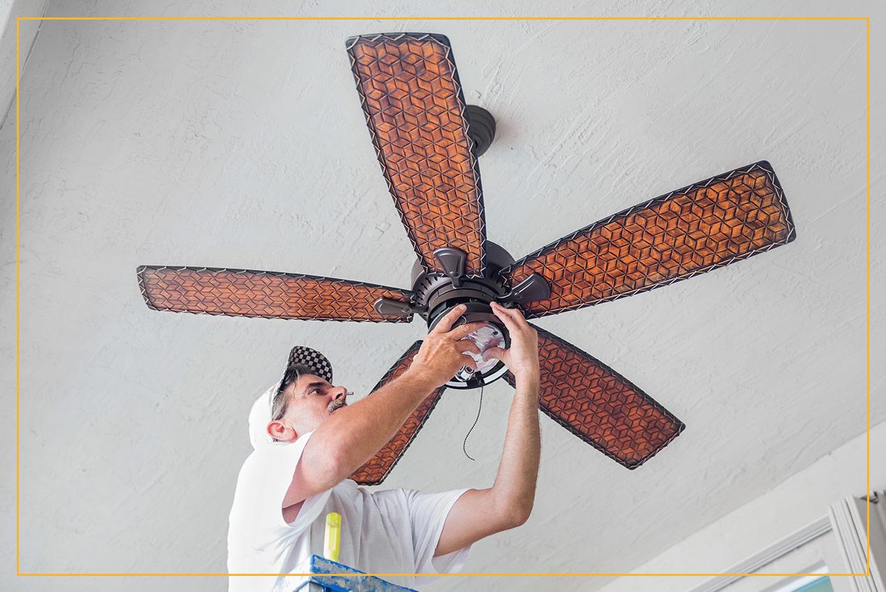 contractor installing ceiling fan