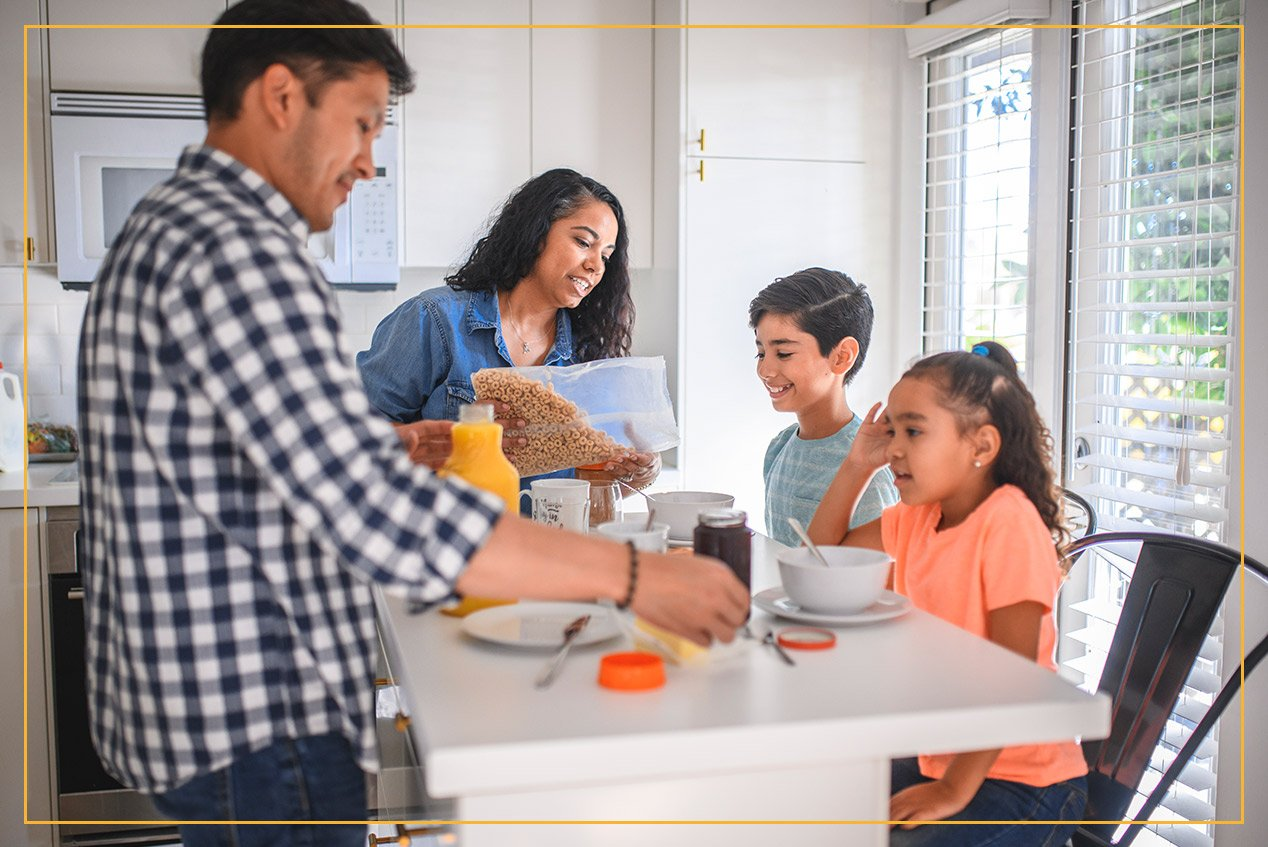 family eating breakfast at kitchen island