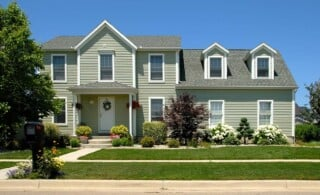 exterior of home with vinyl siding and front yard