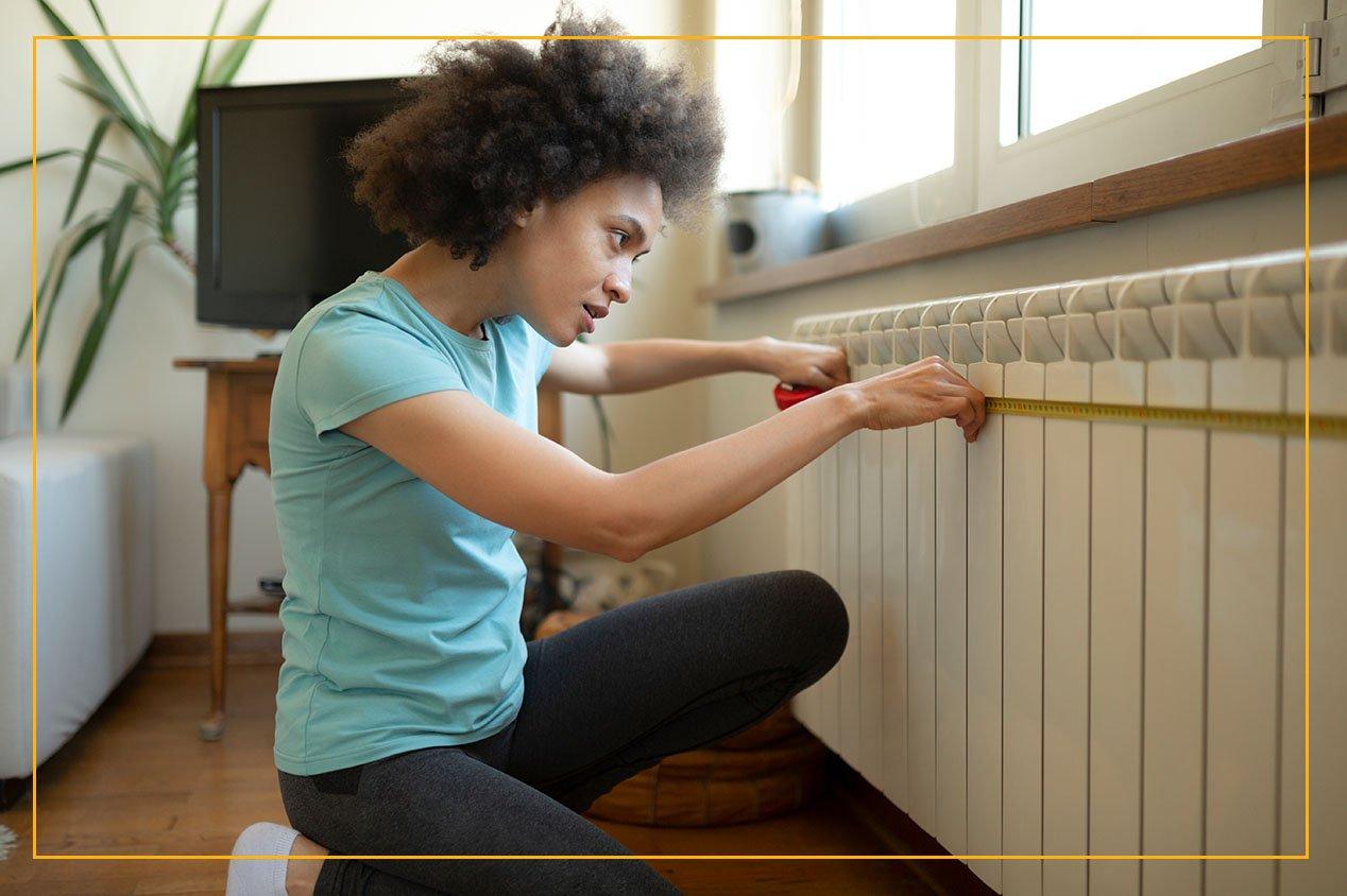 woman checking radiator